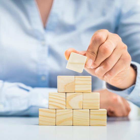 Hand arranging wood block with empty space. Business concept for growth success.